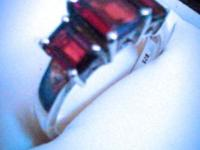 Beautiful silver & garnet ring. Never worn. Size 8. Has