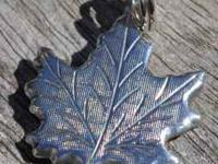 NEVER WORN STERLING SILVER FROM CANADA MAPLE LEAF