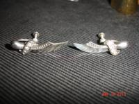 For sale one vintage pair of sterling silver sword