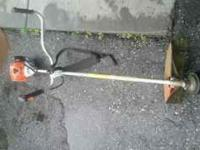 Like new STIHL FS 90 Weed whacker. Low hours. Contact