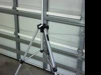 Tripod is in great shape. Locks tight. Comes with carry