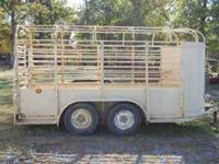 Older stock trailer in fair shape. New floor. Tires are