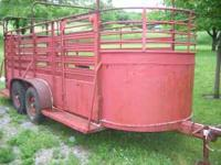 Good and solid 16ft, bumper hitch stock trailer. Has