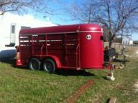 14 foot long covered stock trailer 2008. We dont use it