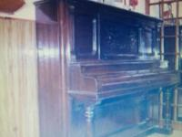 A 100 year old Stodart Piano Co. New York. Upright,