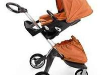 I'm selling a Brand New Orange Stokke Xplory