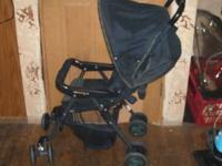 NICE STROLLER BELIEVE NAME IS COMBI NICE MATERIAL FOLDS