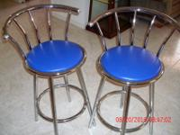 Two very nice stools. Chrome with nice blue vinyl