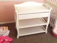 White Storkcraft changing table with drawer and 2