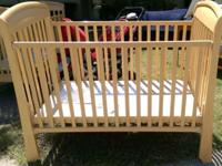 The beautifully crafted Storkcraft Convertible Crib has
