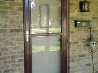 "Full view 36""self storing storm door. Coming off today."