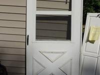 "Storm door 36"" door $30.00 OBO Call 715- six five two-"