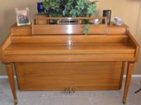 This Mahogany Story & & Clark Piano is in excellent