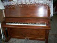 Story and Clark Upright Piano in very nice condition.