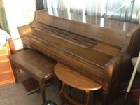 Upright piano in moderately wonderful condition. I am