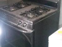 All black gas stove. Used for only 6 months, it was