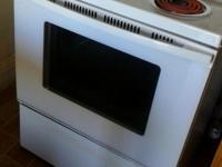 A white whirlpool electric stove. Self cleaning stove