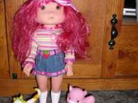 The doll is about 14 inches tall. She has 3 pets & a