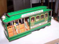 This is a vintage tin litho street car that opperates