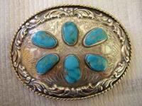 THIS BELT BUCKLE IS MADE BY COMSTOCK SILVERSMITHES AND
