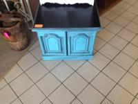 Stressed blue cabinet with doors and black top   Please
