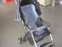 Light weight stroller made by Combi. Easy to fold up