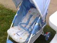 Cosco stroller with Pooh Bear pattern. back reclines,