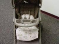 Graco Stroller- light brown in color(netural) and baby