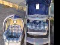 blue and green plaid stroller and carseat set with