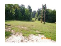 Lender Owned.98 acre lot. The home is located at 497