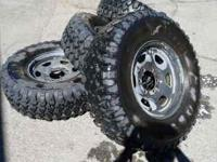 31/10.5/15s on 6 bolt rims studded snow tires . Used