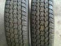 2 almost new studded snow tires for sale with about 100