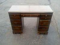 Student desk, solid wood, very stable/sturdy. Thanks