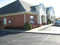 Business complex with easy access and parking.