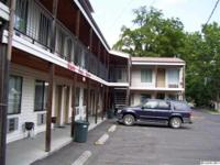 18 unit motel in the downtown business district. Shows