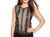 Studio M's chic top features a mesh overlay with