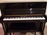 This is a Brentwood studio upright piano purchased in