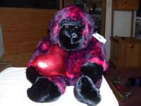 Description this is a stuffed animal it is a black and
