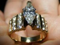 This is a stunning marquise diamond engagement ring