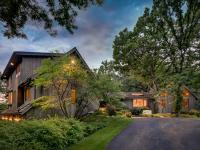 Perched on one a private waterfront five acre lot, this