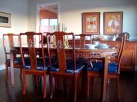 Carved rosewood set includes dining table which expands