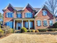 Stunning brick and stone home with inviting front porch