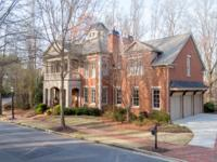 ThisnCharleston-style home is located in the gated