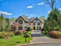 Exquisite River Front Custom home in the prestigious