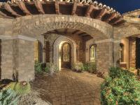 Stunning estate sited on nearly 3 acres in the private,
