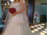 Never been used size 4 wedding dress. If you are