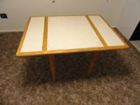 A table made with wood and white tiles for sale. Very