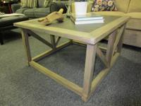 This stylish table is slightly used from a staging