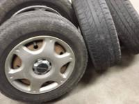 "Selling my 15"" steel wheels with Subaru hub caps with"