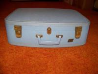 Small hardshell suitcase from Montgomery Wards in